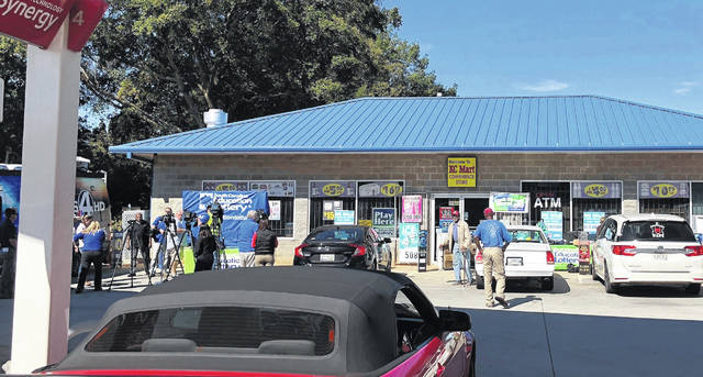Media, at left, record people entering the KC Mart in Simpsonville, S.C., on Oct. 24 after it was announced the winning Mega Millions lottery ticket was purchased at the store. A lottery commission statement says the person submitting the claim for what was the second-largest lottery in U.S. history has chosen to remain anonymous.