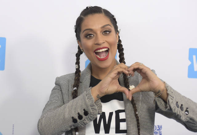 Lilly Singh arrives at WE Day California at The Forum in Inglewood, Calif, in April 19. NBC is shaking up late-night TV, giving Carson Daly's slot to a woman of color who's a star on YouTube.