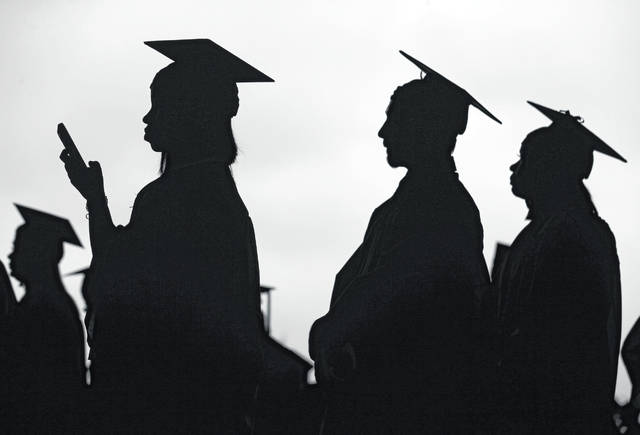 New graduates line up before the start of the Bergen Community College commencement in May 2018 at MetLife Stadium in East Rutherford, N.J. In high school, students hear that they should earn a college degree to have a well-paying, successful career. But student debt isn't good when your degree doesn't lead to a job that earns enough to repay it.
