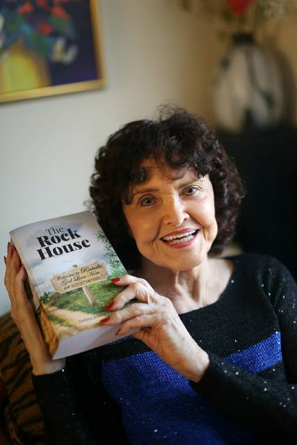 In this Feb. 7, 2019 photo, Delana Close poses with first book in Dublin, Ohio. Delana Jensen Close was recently honored for a book that she finished last year at age 95. In 1955, Delana Jensen Close began to write a book. It's finished now; it just took 63 years.(Courtney Hergesheimer/The Columbus Dispatch via AP)