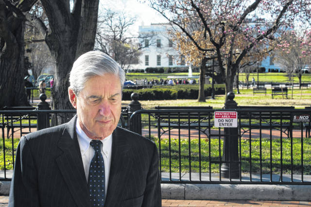 Special Counsel Robert Mueller walks past the White House after attending services at St. John's Episcopal Church in Washington on Sunday. Mueller closed his long and contentious Russia investigation with no new charges, ending the probe that has cast a dark shadow over Donald Trump's presidency.