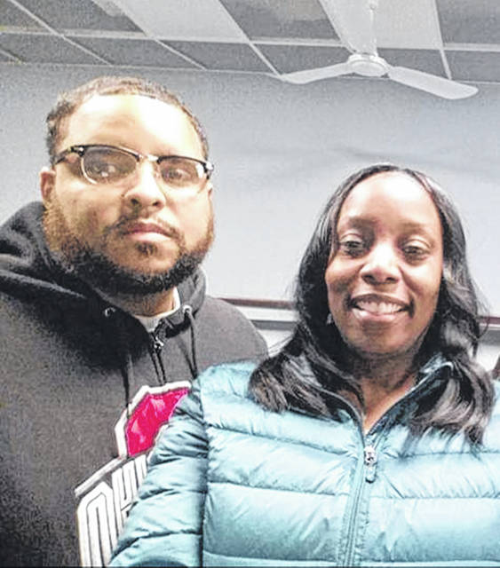 Kevin Tate and Kendra Giles pose for a photo during a Thanksgiving celebration. The two live in Washington, D.C., and Flint, Michigan, respectively, and they see each other when they visit their hometown of Lima.