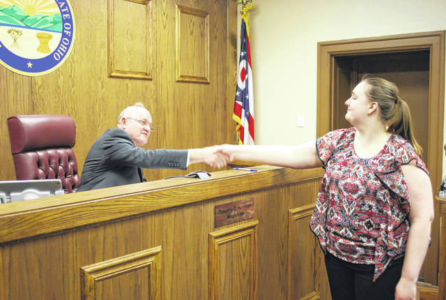 Allen County Probate Court Magistrate Timothy Hamman issued to oath of office to volunteer guardian Rachel Wykoff on Monday.