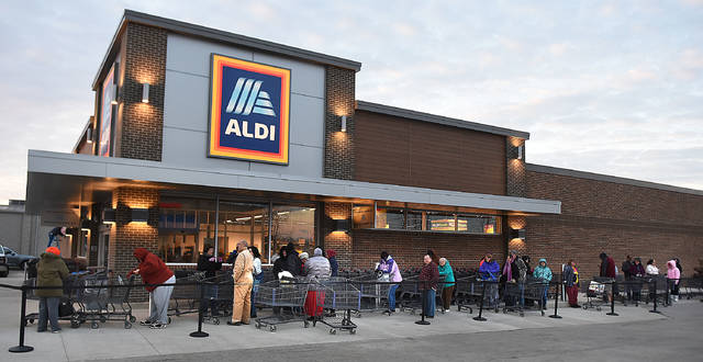 Customers wait outside for the grand reopening of the newly remodeled Aldi Store on Elida Road Monday morning. Craig J. Orosz | The Lima News