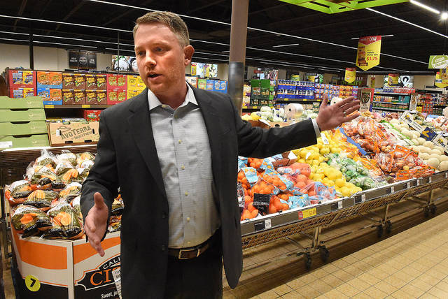 Aldi representative, Ryan Harmon talks about the stores new renovations before the grand reopening of the store on Elida Road. Craig J. Orosz | The Lima News