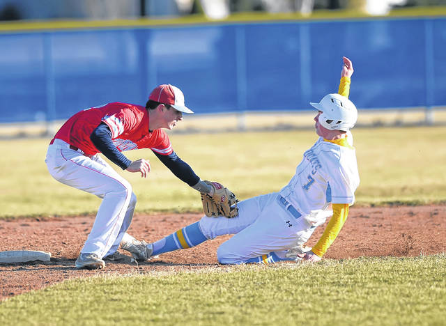 Lima Central Catholic's Michael Briggs tags out Bath's Tyler Mauk during Monday's game at Bath High School.