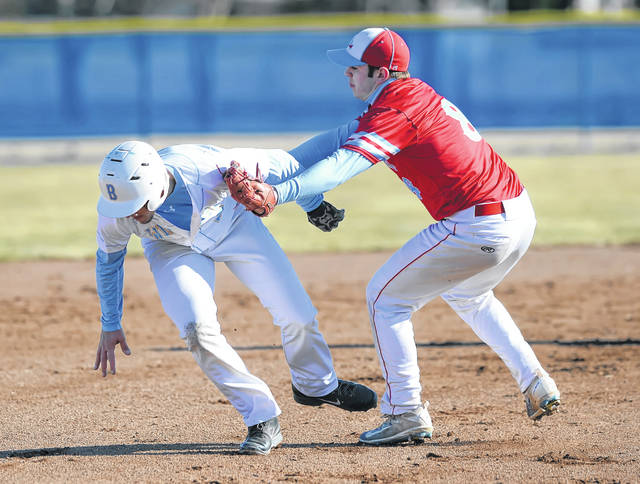 Lima Central Catholic's Dominic Riepenhoff tags out Bath's Caleb Buerger during Monday's game at Bath High School.