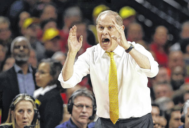 Michigan men's basketball coach John Beilein shouts instructions to his players during the Wolverines' 69-62 win at Maryland on Saturday.