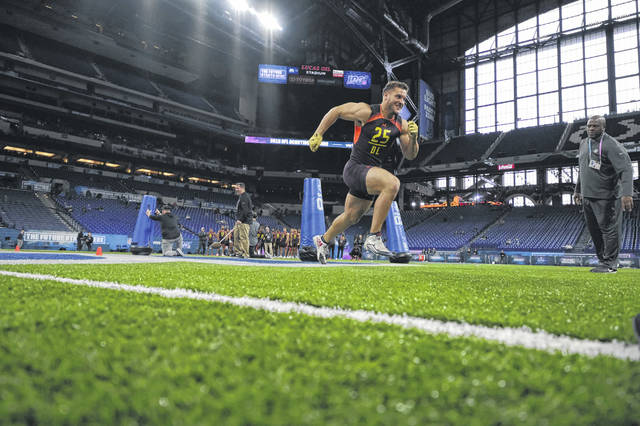 Ohio State defensive lineman Nick Bosa participates in a drill at the NFL football scouting combine in Indianapolis. Bosa wanted to prove he has recovered from an injury that sidelined him most of his final season at OSU and appeared to do that at the combine.