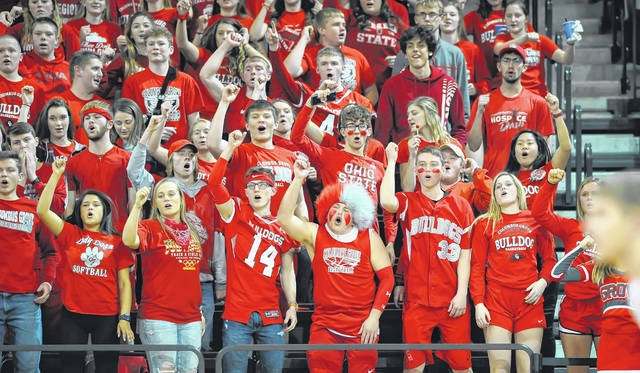 Columbus Grove students cheer on the Bulldogs during a Tuesday night Division IV regional semifinal at the Stroh Center in Bowling Green.