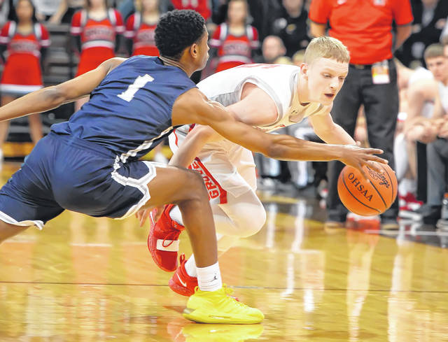 Columbus Grove's Gabe Clement drives against Maumee Valley Country Day's Zeb Jackson during a Tuesday night Division IV regional semifinal at the Stroh Center in Bowling Green.