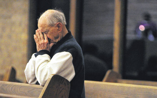 A worshiper prays during morning mass at Sacred Heart Catholic Church on Thursday, Feb. 28, 2013 in Conroe, Texas. Pope Benedict XVI will become the first pontiff to resign in 600 years.  (AP Photo/ The Courier, Jason Fochtman)