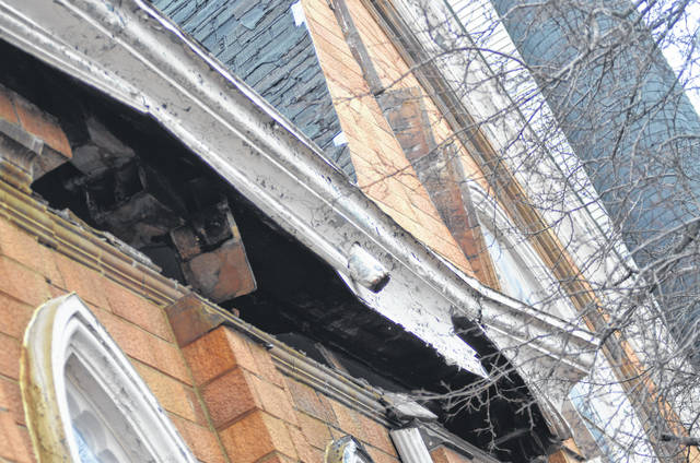 The roof on the church's east side is slowly ripping away from high winds.