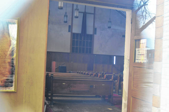 Looking in through the front door, the interior of the building is little changed from since the building was shuttered.