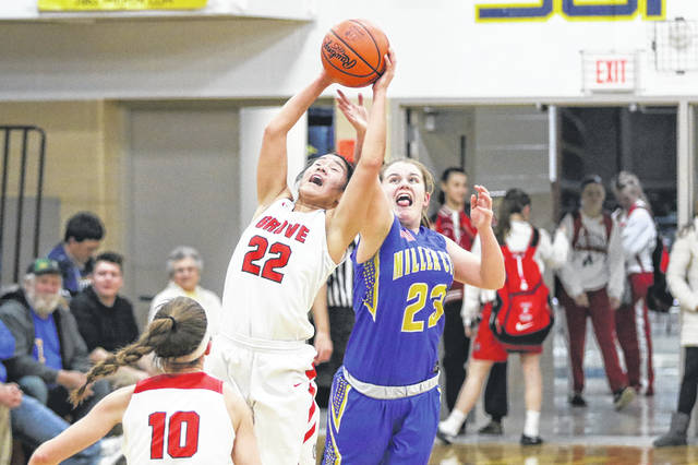 Columbus Grove's Amy Vorst, left, and Miller City's Natalie Koenig battle for possession of the ball during a Thursday night Division IV district semifinal at Ottawa-Glandorf.