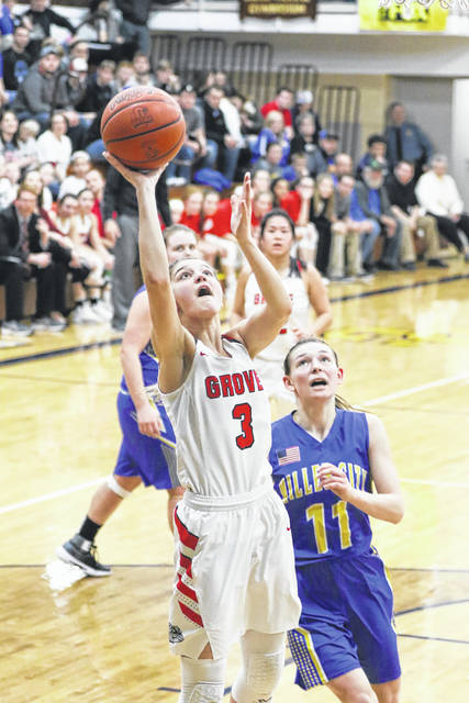 Columbus Grove's Sydney Witteborg goes up for a shot against Miller City's Abi Lammers during a Thursday night Division IV district semifinal at Ottawa-Glandorf.