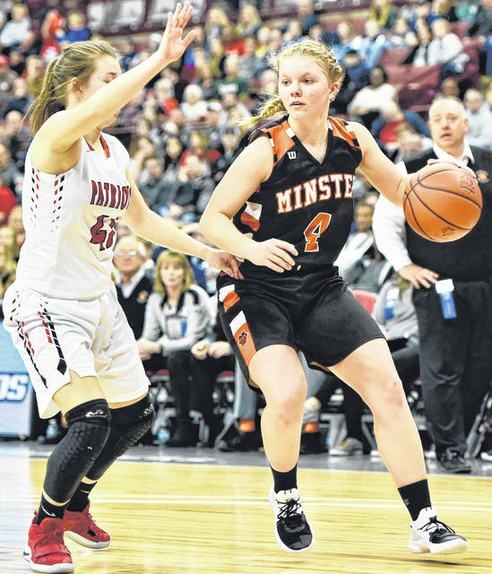 Minster's Ivy Wolf drives against Cornerstone Christian's Kristen Suszek during a Division IV state semifinal Friday at the Schottenstein Center in Columbus.