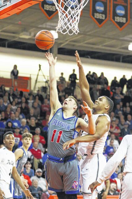 Crestview's Colton Lautzenheiser puts up the shot against Maumee Valley Country Day's Parker Chatman during Friday night's Division IV regional final at the Stroh Center in Bowling Green.