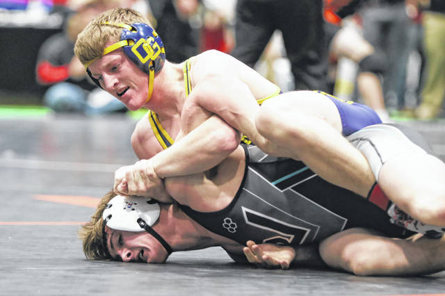Ottawa-Glandorf's Evan Ellerbrock, top, competes against Bidwell River Valley's Nathan Cadle during Saturday's Division III district at Troy's Hobart Arena.
