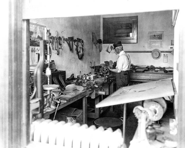 James E. Grosjean, photographed at his cobbler's bench in an unknown year. He was involved in several business pursuits and is best known today for his mechanized Noah's Ark.