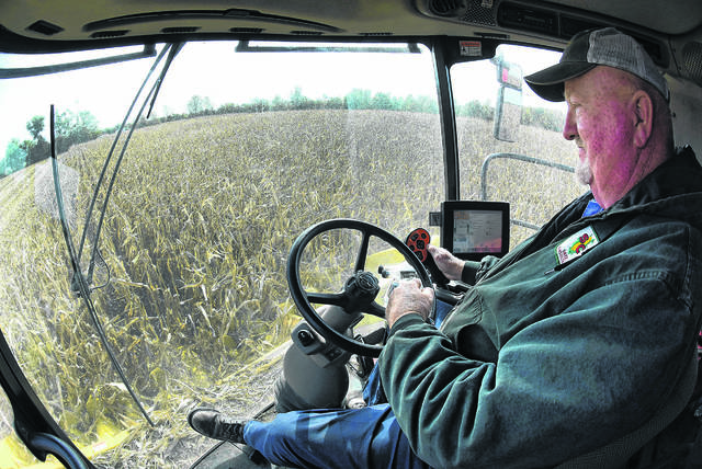 "Craig Shaw operates a Case 8120 combine while harvesting 75 acres of field corn at the Steiner Farm along State Route 117 in October. ""We're having a great harvest this year,"" Shaw said."
