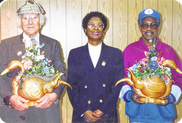 Albert Gore Sr., left, poses for a photo with Herb Sherrell, right, and some of the ducks Sherrell had made.