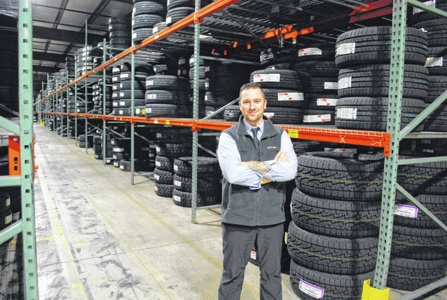 Dave Miller, marketing manager at K&M Tire, stands in the warehouse of the Delphos-based company, surrounded by tires that are bound for retailers in several states.
