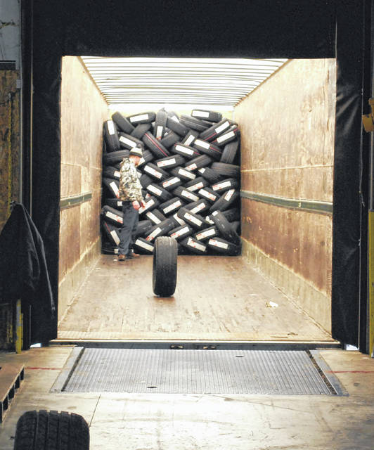 Tires are unloaded off a semi at K&M Tire in Delphos in anticipation of shipment to retailers throughout the area.