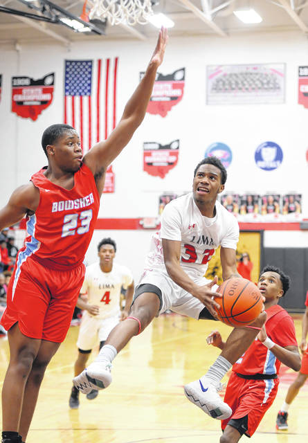 Lima Senior's Jermaine Daniel goes up for a shot against Bowsher's Aric McCrimmon during a Friday night Division I sectional final at Fostoria High School.