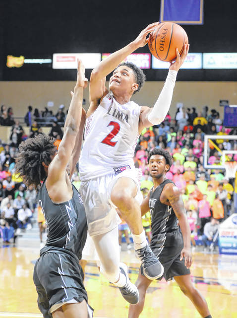 Lima Senior's Josiah Fulcher shoots against Toledo Start's Adrian Michael during Wednesday's Division I Regional game at the Savage Arena in Toledo.