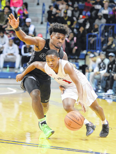 Lima Senior's Khalil Luster drives past Toledo Start's Devin Williams during Wednesday's Division I Regional game at the Savage Arena in Toledo.