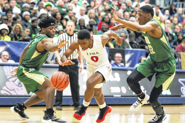 Lima Senior's Da'San Clair dribbles past St. Vincent-St. Mary's Malaki Branham (22) and Seth Wilson during Saturday night's Division I regional final at the University of Akron's James A. Rhodes Arena.