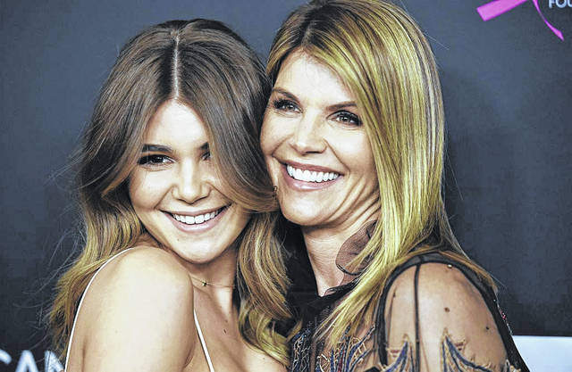 """Lori Loughlin, right, played Aunt Becky on """"Full House."""" She and her husband allegedly agreed to pay bribes totaling $500,000 to have their two daughters designated as recruits to the University of Southern California crew team. She is pictured with her daughter, Olivia Jade. AP Photo"""
