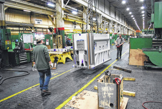 Large presses are moved through the assembly process at Nidec/Minster Machine Corp. using heavy duty hoists.