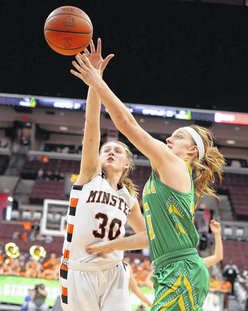 Ottoville's Haley Hoersten puts up a shot against Minster's Courtney Prenger during Saturday's Division IV state championship game at Value City Arena in Columbus.