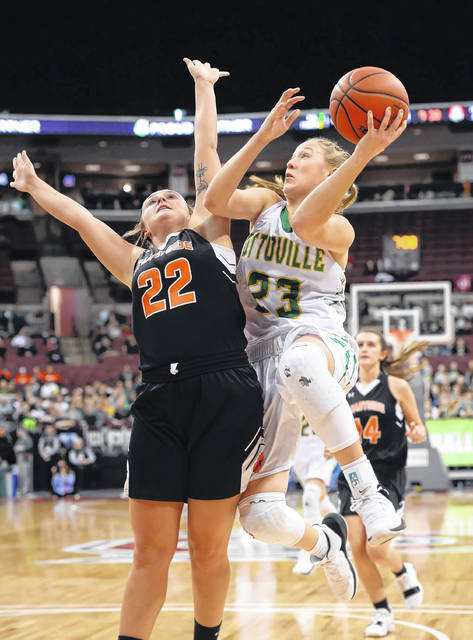 Ottoville's Kasey Knippen puts up a shot against Shadyside's Jaycee Mayeres during a Friday Division IV state semifinal at Value City Arena in Columbus.