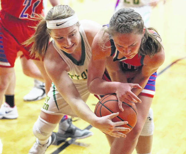 Ottoville's Haley Hoersten and Wayne Trace's Miriam Sinn fight for control of a rebound during Saturday night's Division lV district final at Van Wert.