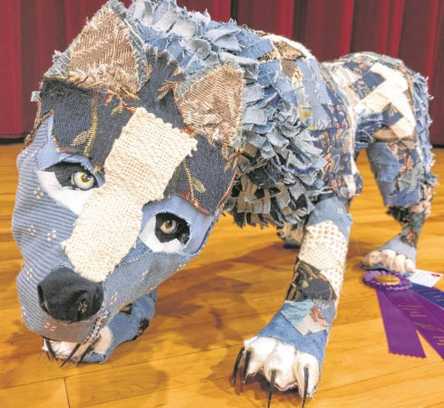 """Grace Fishbach, a 9th grader from Fort Jennings High School, won a """"Best of Show"""" ribbon foor her mixed media work entitled """"Old Hunter."""""""