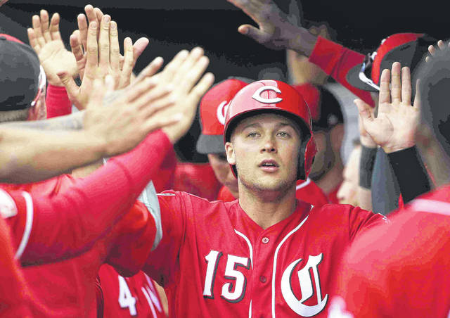 Cincinnati Reds' Nick Senzel (15) celebrates his run scored against the Cleveland Indians during the second inning of a spring training baseball game Monday, March 11, 2019, in Goodyear, Ariz. (AP Photo/Ross D. Franklin)