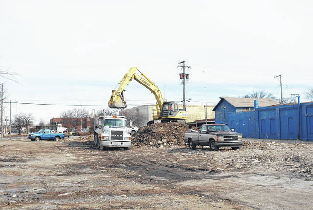 Crews continued their clean-up efforts Friday at the site of the former Royal Inn on Market Street near downtown Lima after city officials late last month filed a motion in Allen County Common Pleas Court against Rashmikant Patel, owner of the property, for failing to meet agreed-upon deadlines for removing debris from the site. As of noon Friday the overwhelming majority of debris had been removed from the property.