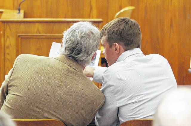 Gabriel Salyers confers with his attorney, John Fisher, at the opening of testimony Wednesday in Salyers' murder trial. The Lima man is charged in the April 2018 death of 18-month-old Jaxxon Sullivan.