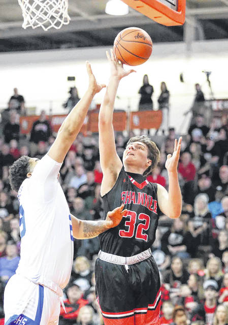 Shawnee's George Mangas puts up a shot against Columbus South's Samual Barton during Saturday's Division II regional championship game at Bowling Green State University's Stroh Center.