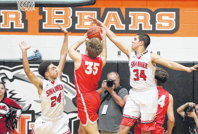 Shawnee's Tyson Elwer (34) and Sheridan O'Neal (24) will need another big night of rebounding if they are going to compete against the Cleveland Central Catholic front line.