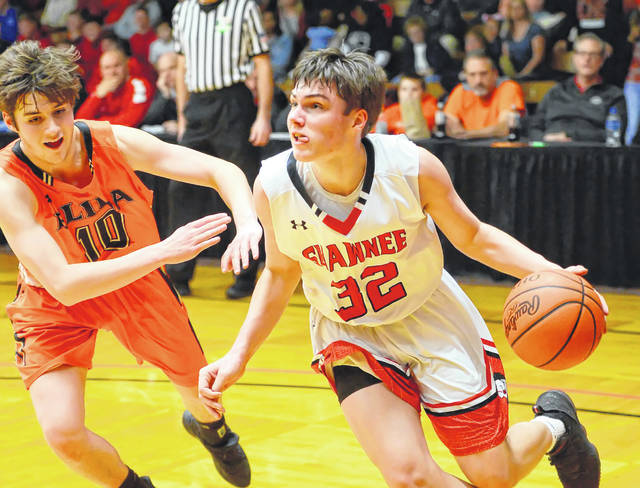 Shawnee's George Mangas drives against Elida's Max Parker during Wednesday's Division II District game at the ONU Sports Center in Ada.