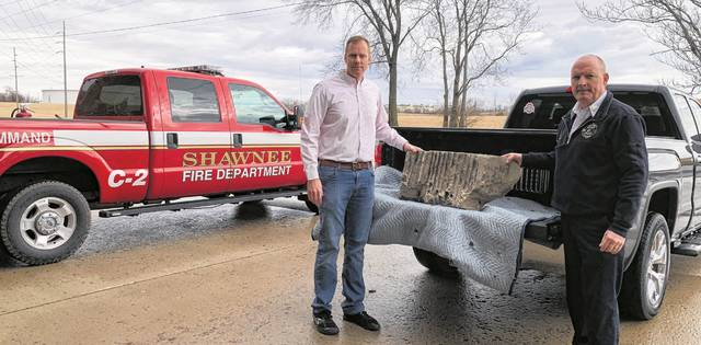 Jeff Rosebrock (left), President of the Allen County 9/11 Memorial Foundation and Todd Truesdale (right), Shawnee Township Fire Department Chief presented the limestone piece Wednesday afternoon.