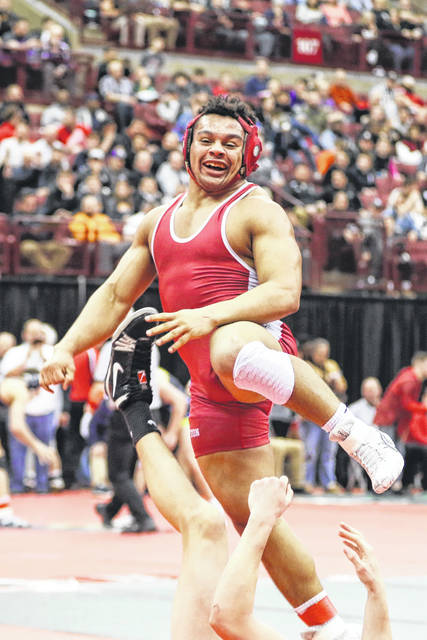 Bluffton's Deandre Nassar reacts after defeating Barnsville's Brylan Clouse in a Division III championship semifinal Friday night at the state wrestling tournament at the Schottenstein Center in Columbus.