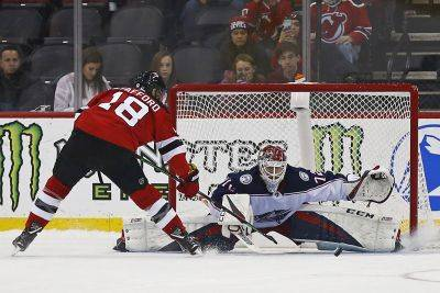 Columbus goaltender Sergei Bobrovsky makes a save against New Jersey's Drew Stafford (18) during a shootout Tuesday night in Newark, N.J. (AP photo)