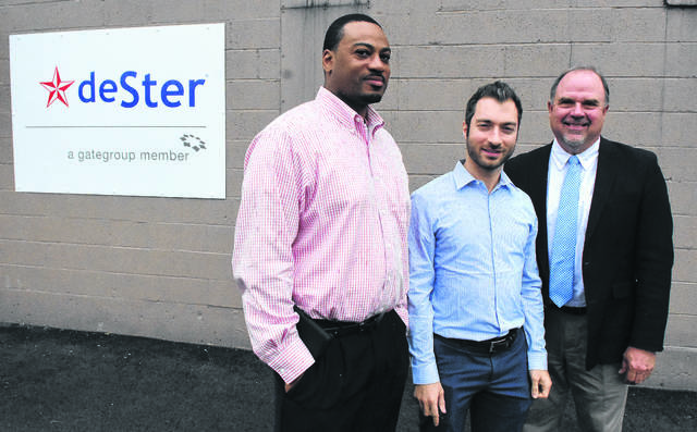 deSter's production manager Vernon Hines, left, and corporate development director Johnny Kattar pose outside the company's new facility on Lima's Kibby Street along with Dave Stratton, of Allen Economic Development Group, in September 2016.
