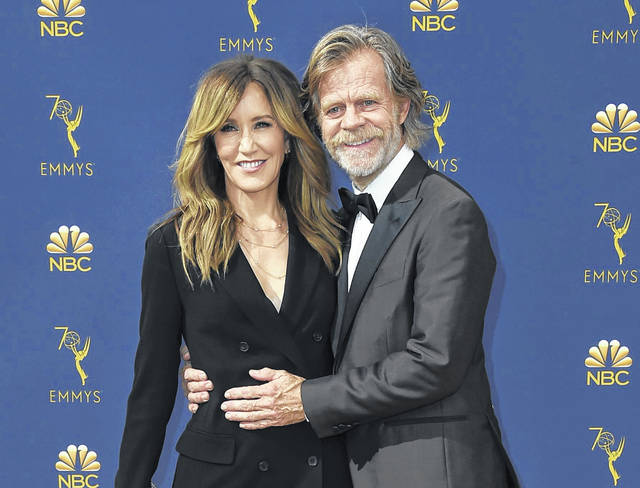 """Felicity Huffman garnered fame from her role on the TV show """"Desperate Housewives."""" She is shown with her husband, actor William H. Macy, who starred in the movie, """" """"Fargo."""" Huffman was led away from her home in handcuffs. AP Photo"""