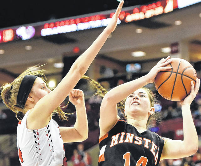 Minster's Karly Richard puts up a shot against Cornerstone Christian's Kailey Tyna during a Division IV state semifinal Friday at the Schottenstein Center in Columbus.